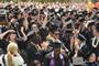 Graduates celebrate at Commencement 2012.<em><span style=font-size:9pt;>&nbsp;Credit: Bob MacDonnell</span></em>