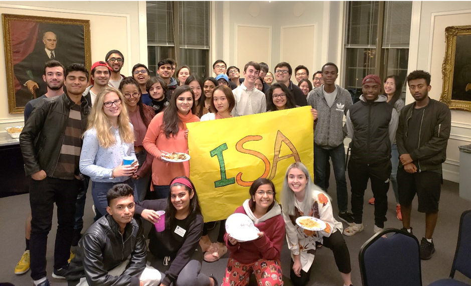 Students pose as a group after the Fall Weekend parentless dinner