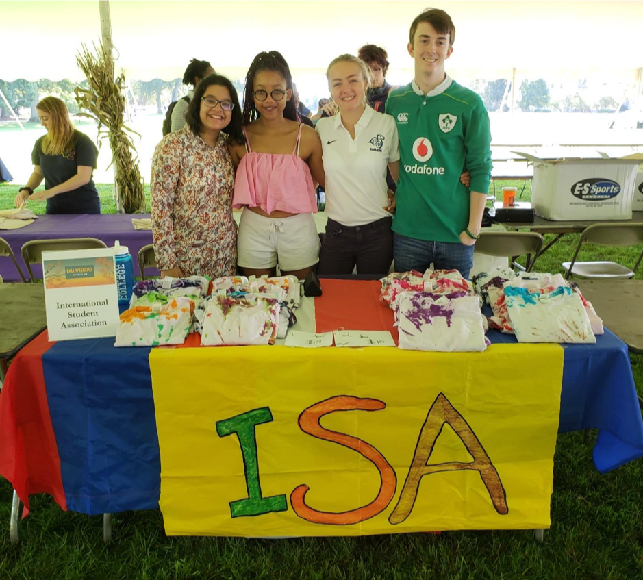 Samirah poses with members of the International Student Association's table at Harvestfest