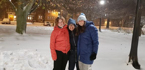 Samirah and her two friends pose for a photo together outside in the snow