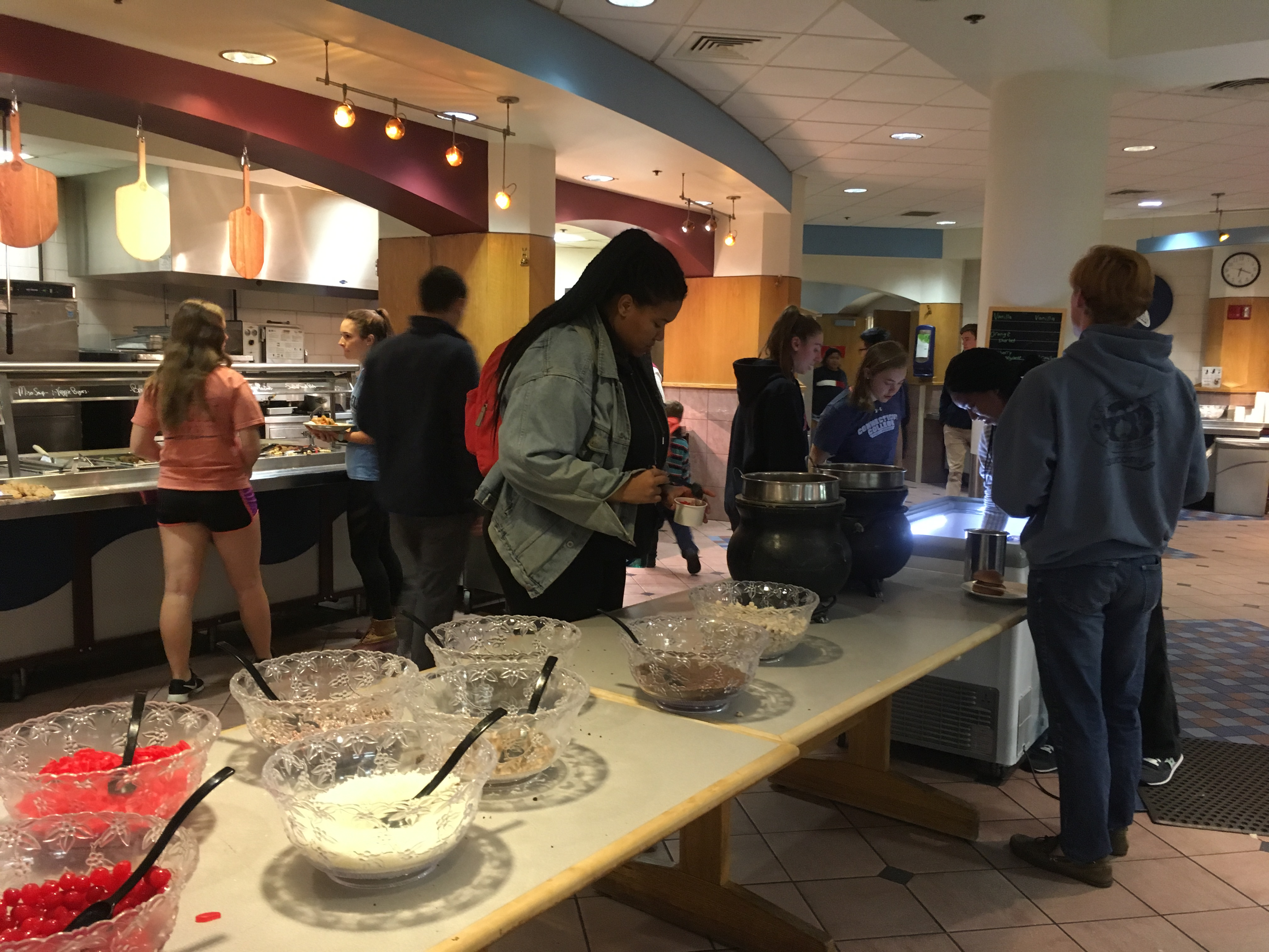Students pour toppings on top of their sundae's at Harris Dining Hall's Sundae Sunday event
