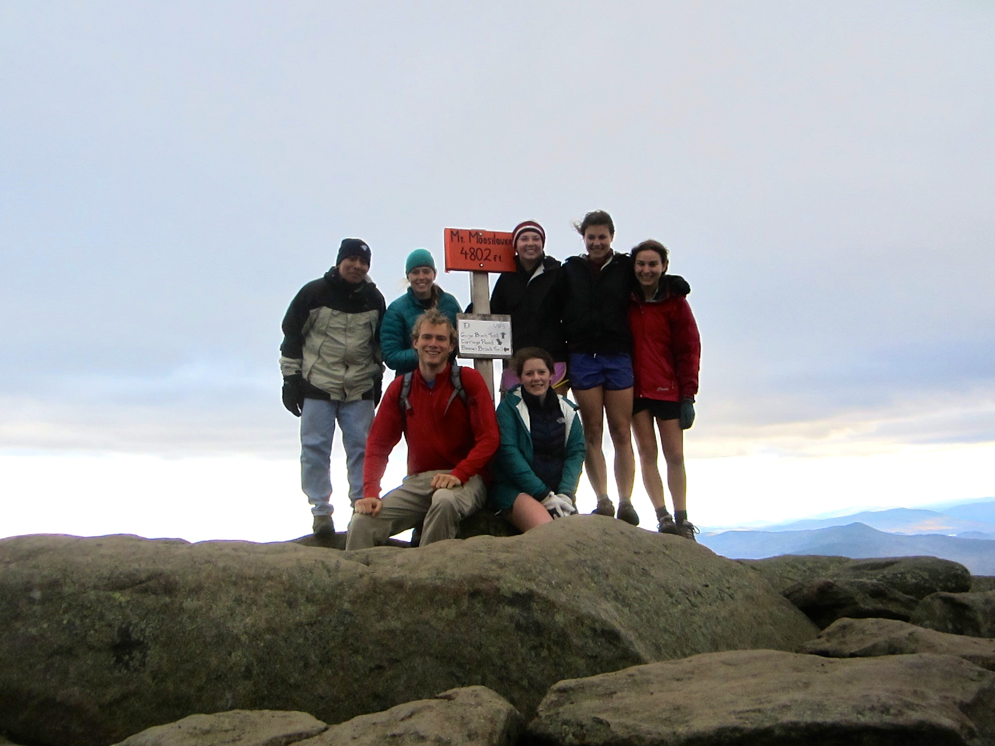 The Outdoors Club poses at the summit of Mt. Moosilauke