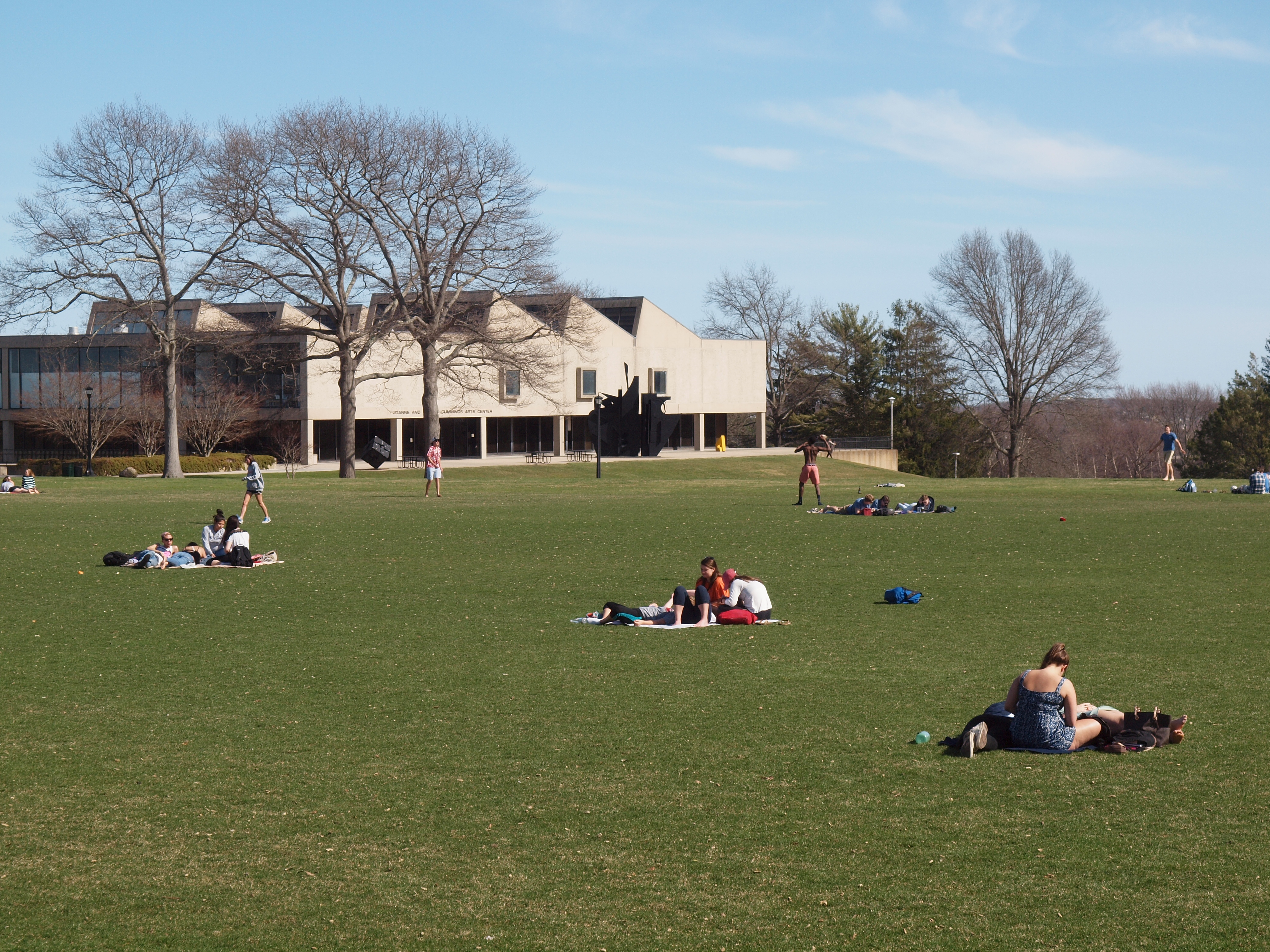 Students relax on a field