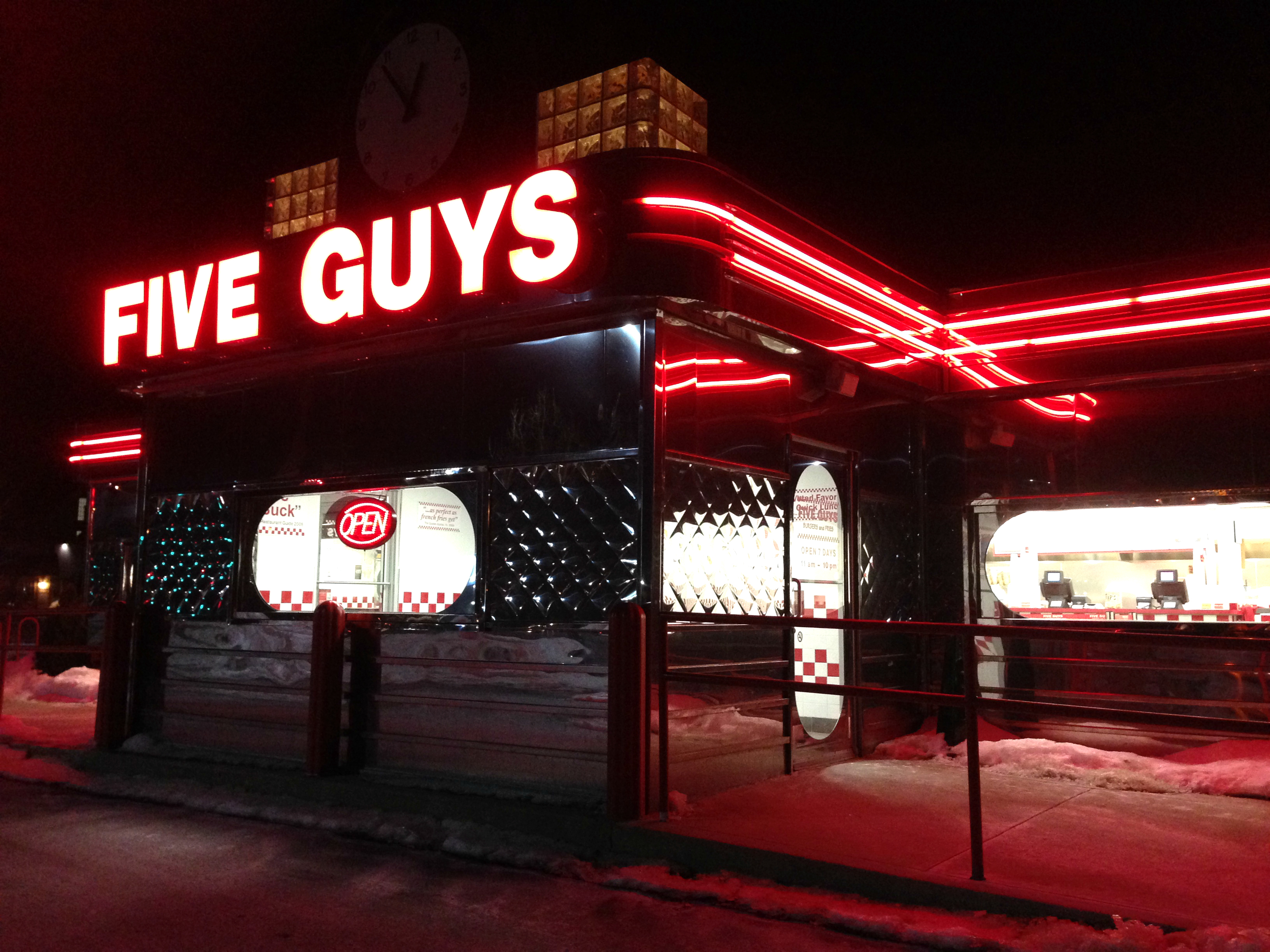 The outside of a Five Guys fast food restaurant