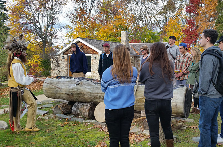 Students in Anthropology 114 (Power and Inequality in a Global World) learn about Mohegan lifeways and methods for making dug-out canoes.