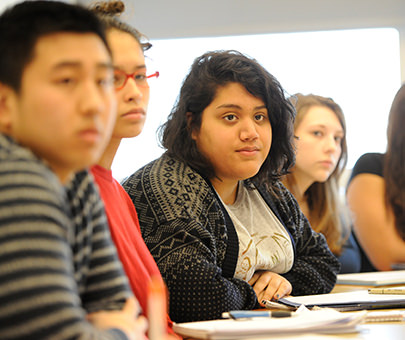 Psychology students listen to a lecture in the classroom.