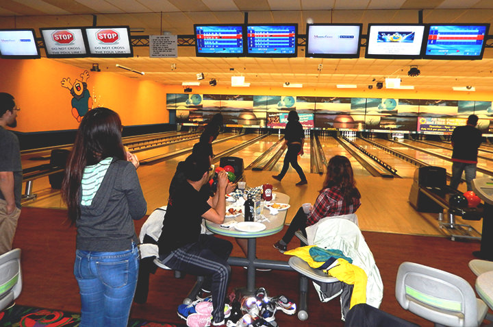 Sociology students enjoy a bowling together.