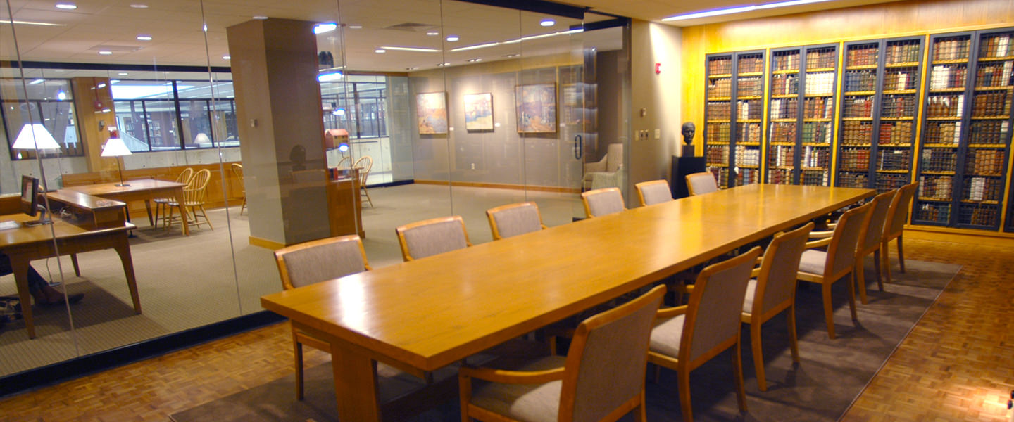 A long meeting table is found in the Lear Center