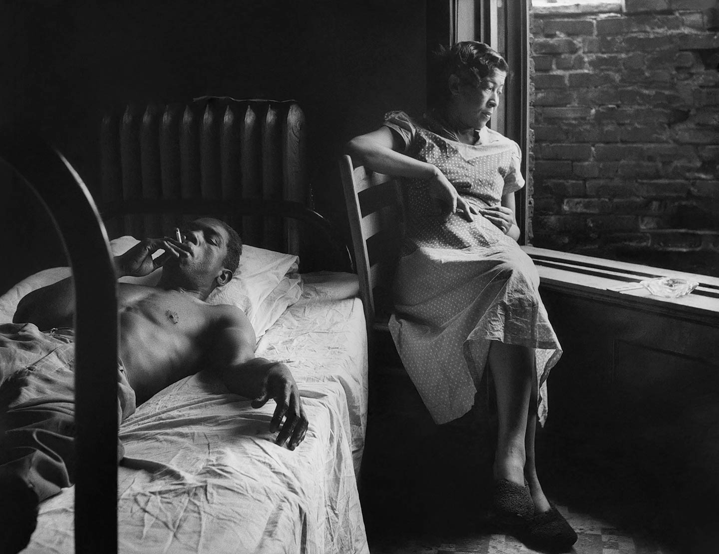 Tenement Dwellers, Chicago, Illinois, 1950, man and woman in tenement