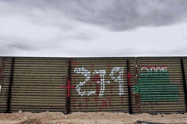 Cloudy sky and border wall that separates Douglas, Arizona, and Agua Prieta, Mexico