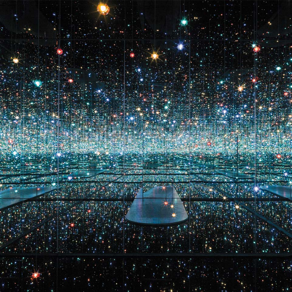 Infinity Mirrored Room – The Souls of Millions of Light Years Away, 2013. Wood, metal, glass mirrors, plastic, acrylic panel, rubber, LED lighting system, acrylic balls and water, 113 1/4 x 163 1/2 x 163 1/2 in.  Courtesy of David Zwirner, N.Y. © Yayoi Kusama