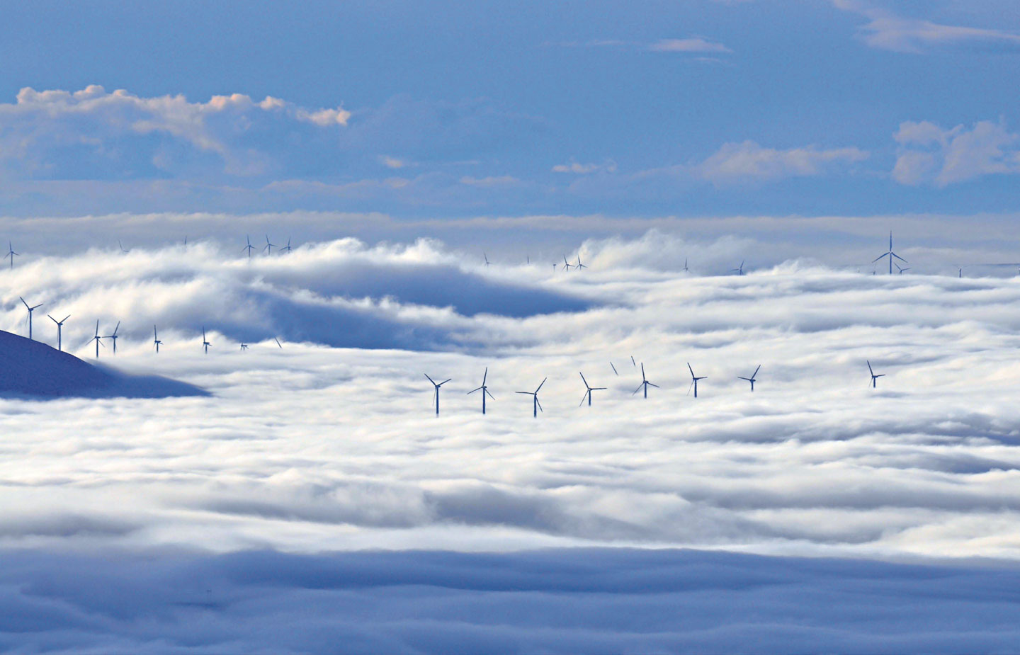 Image of windmills in the clouds