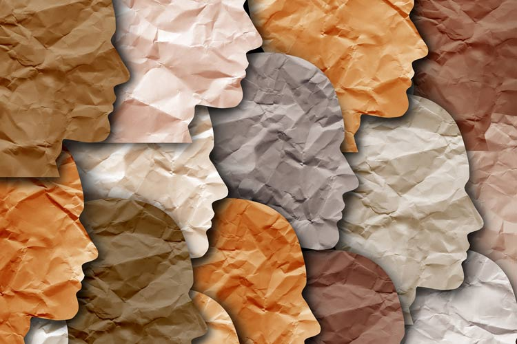 Abstract image of cut-paper heads of different colors