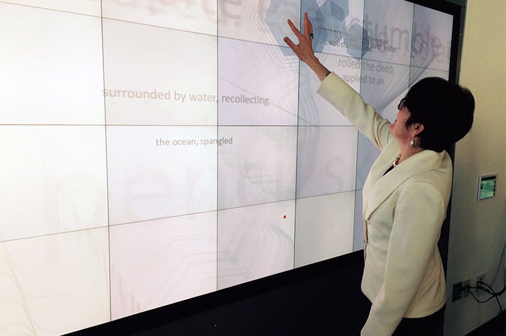 Katherine Bergeron using the Diane Y. Williams '59 Christie MicroTile Visualization Wall