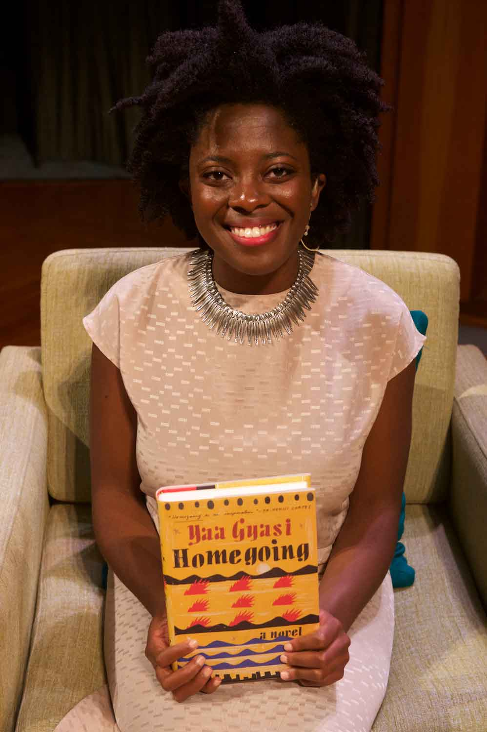 "Author Yaa Gyasi holds her debut novel, ""Homegoing"""