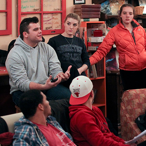 Students converse in residence hall coffee shop