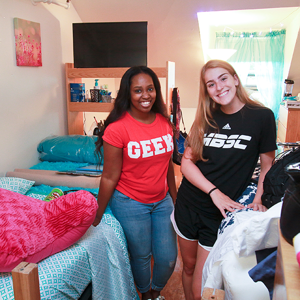 Roommates pose for a photo