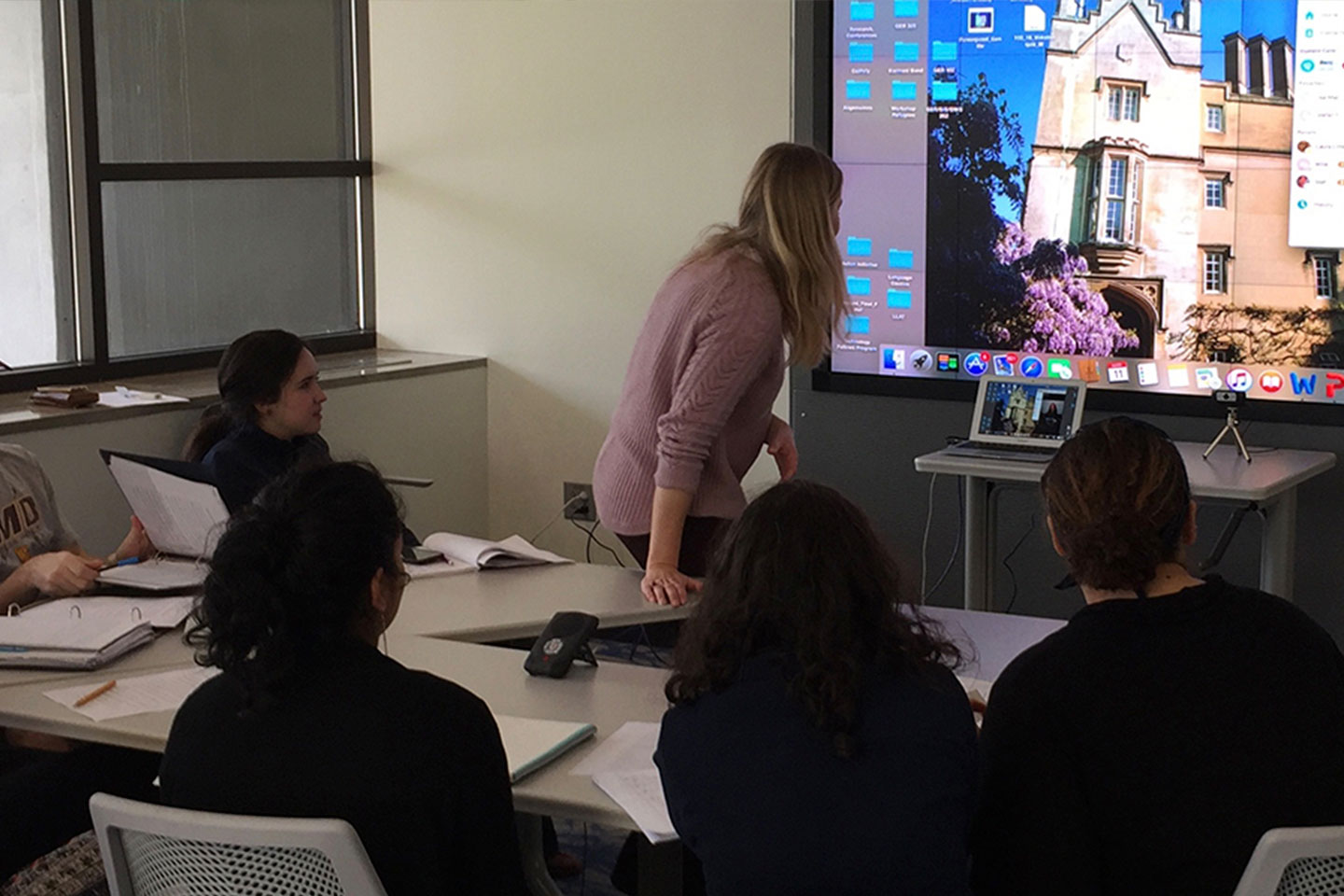 Students in a classroom videoconferencing with another classroom