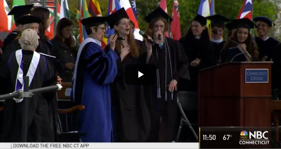 Screenshot from video. Katherine Bergeron performs the Alma Mater Remix with students at Commencement.