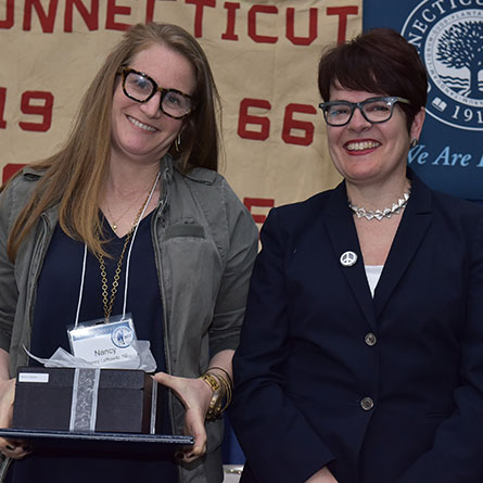 Nancy E. Lefkowitz '92 receives the Agnes Berkeley Leahy Award for outstanding service from President Katherine Bergeron.