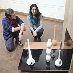"Anique Ashraf '17 (left) and Prapti Kafle '16 examine work by Connecticut College Professor of Art Denise Pelletier on display in New London's Lyman Allyn Art Museum as part of ""Transmissions: Teaching and Learning in the Studio,"" an exhibit that runs through June 7."