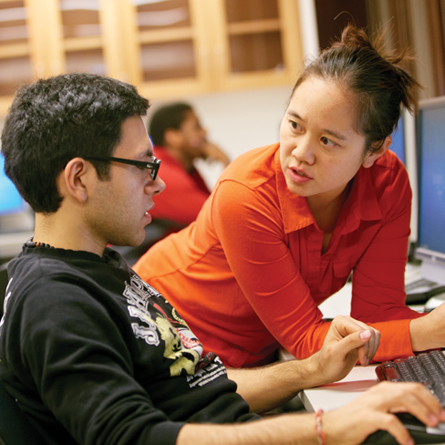 Christine Chung, Tempel Professor of Computer Science, works with a student.