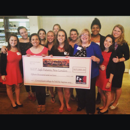 Bettina Weiss '15, center, the As Told By Vaginas leadership team, and Director of Sexual Violence Prevention and Advocacy Darcie Folsom, back right, present a $15,000 check to Cathy Zeiner, executive director of Safe Futures.
