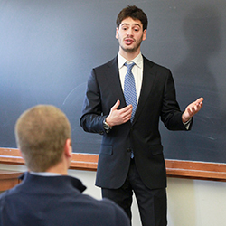 Sam Siegel-Wallace '15 gives a presentation on the last day of the Now Hiring! workshop. (Homepage: Steven Natera '15, far right, presents to Connecticut College career advisers and representatives from Preston Ridge Vineyards.)
