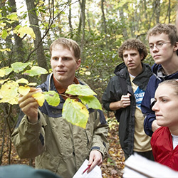 Chad Jones, associate professor of botany and faculty director of the Office of Sustainability at Connecticut College, teaches a class in the College's 750-acre arboretum.