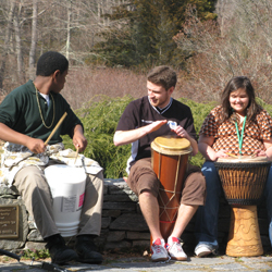 Connecticut College students host a drumming circle with students from New London's Bennie Dover Jackson Middle School. The middle school students were on campus as part of an after-school enrichment program.