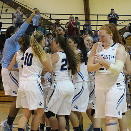 The women's basketball team celebrates their recent 61-55 home victory over nationally ranked Tufts, improving their record to 8-0.