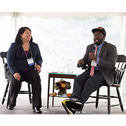 "Andre Robert Lee '93, right, and Liza Talusan '97 discuss Lee's newest film, ""I'm Not Racist, Am I?"" during Connecticut College's Fall Weekend celebration."