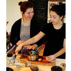 Emily MacGibeny '16 (left) and Azul Tellez '15 are putting their Davis Prize for Peace grant to good use by bringing healthy meals and cooking classes to an impoverished section of Portland, Ore.