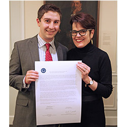 SGA President Evert Fowle '14 (left) and President Katherine Bergeron signed a copy of the College's Shared Governance Covenant in February. The document, which each year reaffirms the College's commitment to shared governance, is also signed by the chairs of the faculty and staff representative bodies.