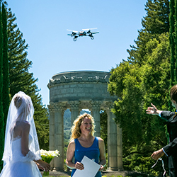 Ring bearer: A quadcopter drone delivers wedding bands to Otavio and Zina Good during their July 2013 wedding ceremony at Pulgas Water Temple in Redwood City, Calif. Image illustration based on photograph by Frances VonWong.