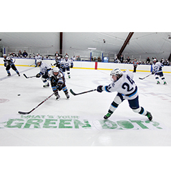 Taking a stand: Marc Roper '15 clears the puck during the men's hockey team's first Green Dot game in 2012. The event, which raises awareness for the sexual assault-prevention training program, has since become an annual tradition. Homepage: Real examples of '
