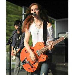 Haley Gowland '17 sings lead for the Cranks as the band opened for Paramore, Fall Out Boy, and New Politics in New Hampshire.