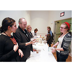 Jenny Morrissey '18, right, has her books signed by authors Colum McCann and Jessica Soffer '07. McCann and Soffer were on campus to discuss their work and the process of writing as part of Connecticut College's Daniel Klagsbrun Symposium on Creative Arts and Moral Vision.