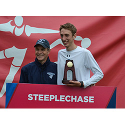 Mike LeDuc '14, pictured here with Coach Jim Butler, wins his third NCAA national championship today with a posted time of 8:45.77 in the 3,000 meter steeplechase.