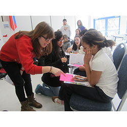 Sophomores Dana Sorkin, Lizz Ocampo, and Kaitlin Cunningham teach Russian to New London middle-schoolers at last year's International Student Expo, which was supported by the Mellon Initiative on Foreign Languages.