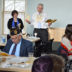 Rabbi Aaron Rosenberg leads the first Seder at Zachs Hillel House, which opened in January. Photo by Grace Griffin '14.