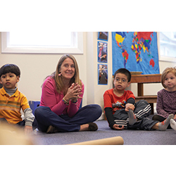 Julie Mombello '83 works with students at the Adam J. Lewis Preschool in Bridgeport, Conn.