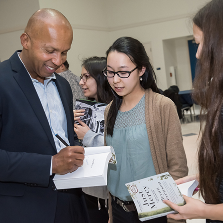 Bryan Stevenson chats with students as he signs copies of his book,