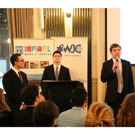 Daniel Kramer '18 (left), Connor Wolfe '17 (center) and Simon Luxemburg '18 (right) present during the live pitch competition at Manhattan's WeWork Bryant Park.