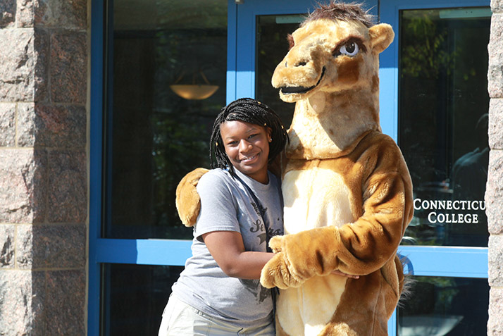 A student poses with the Camel mascot