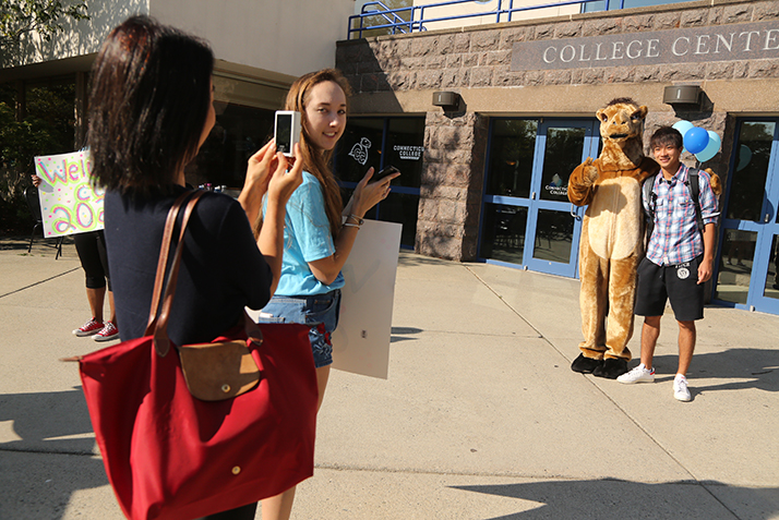 Students take pictures with the Camel