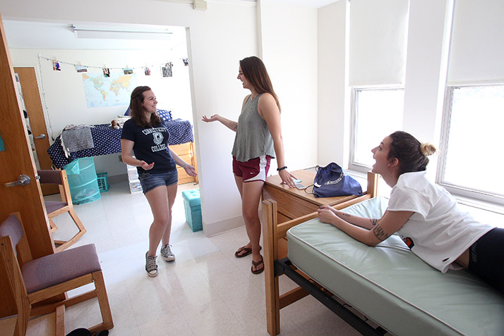 Roommates relax in their new room