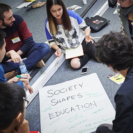 Lera Shynkarova '20 (center) shared ideas with other youth representatives from around the world during a workshop at the World Forum for Democracy.