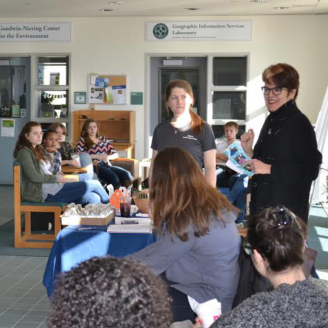 President Katherine Bergeron (right, standing) greeted a group of local high school students during the recent
