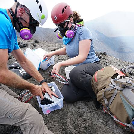 Alex Iezzi '15 and her graduate school adviser, David Fee, set up infrasonic microphones on the crater rim of Yasur Volcano in Vanuatu. Photo by Allison Austin courtesy of David Fee.